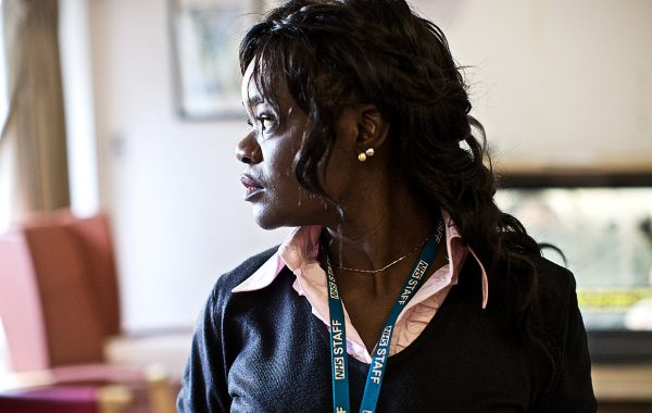 An NHS worker with a lanyard