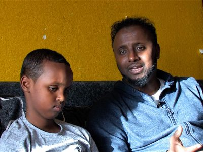 A boy and his father in the short film Overcoming Barriers