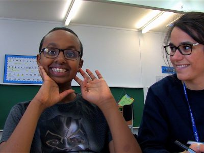 A boy and teacher in the short film Overcoming Barriers