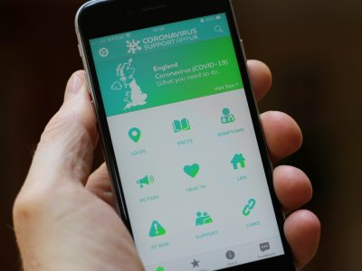 A mobile phone with the Coronavirus Support App welcome screen