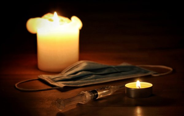 A face mask, candles and syringe