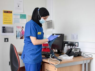 An NHS worker in a face mask