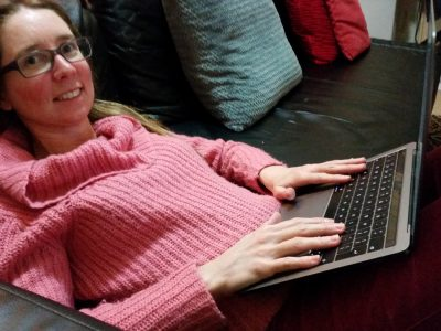Susan Pywell of our plain language panel, on her laptop