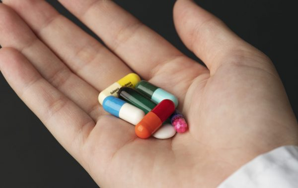 A selection of pills in a person's hand